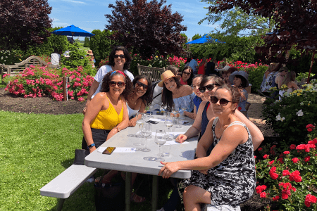 Customers enjoying a lovely sit down in beautiful wine country- New York Wine Tasting Tour.